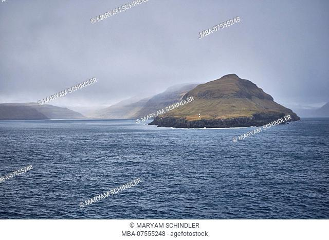 Iceland, east Fjords in the arctic ocean, cloudy sky and blue water