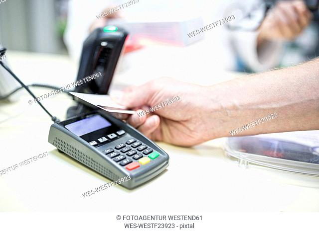 Cashless payment at shop counter
