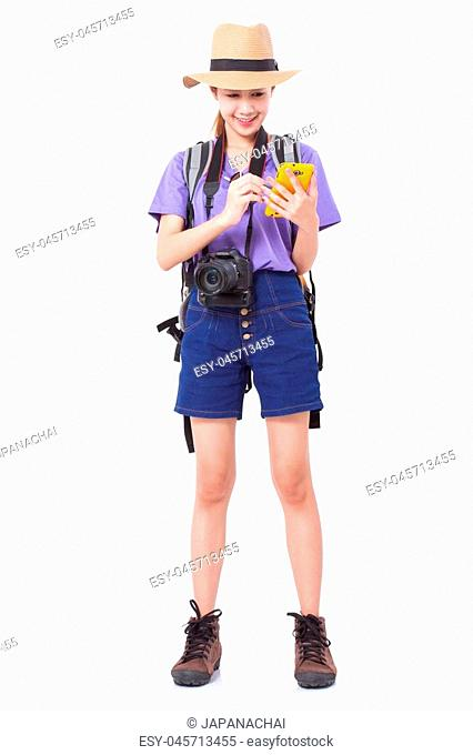Woman traveler with backpack and using smartphone in searching locations, white background