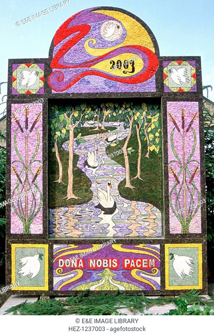 'Dona Nobis Pacem', well dressing, Youlgreave, Derbyshire. Well dressing is a custom practised in the English Peak District which involves the decoration of...