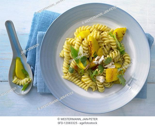 Curry & mango pasta with cashew nuts and coriander