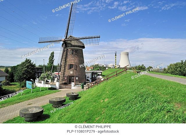 The windmill Scheldedijkmolen and cooling towers of the Doel Nuclear Power Station along the river Scheldt at Kieldrecht / Beveren, Belgium