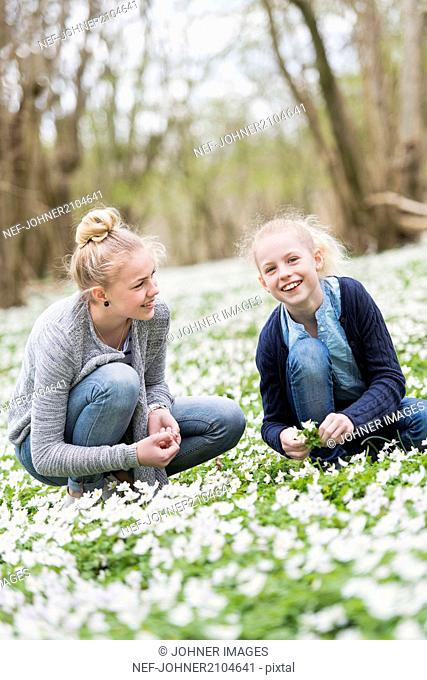 Young woman with sister in park