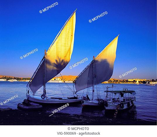 Evening light on the sails of two feluccas on the bank of the Nile opposite Luxor, Egypt Egypt - Nil - Boats - Sunset - Luxor, Nil, -gypten, 10/02/2006