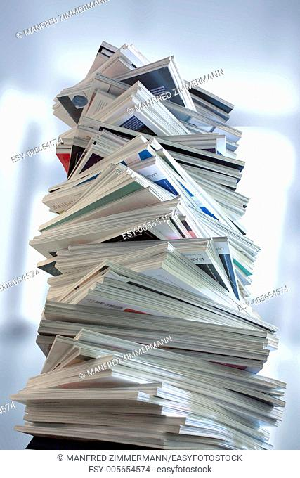 A lot of stacked magazines