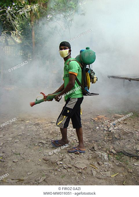 A City Corporation worker sprays insecticides, in a drive under taken by Jessore City Corporation to repel mosquitoes from the town Bangladesh March 15, 2009
