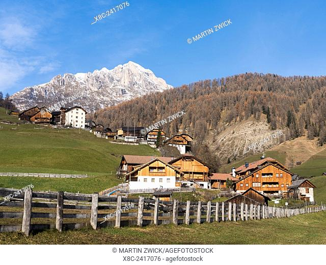 Cluster of traditional farm houses called Viles in the hamlets of Mischi und Seres, village of Campill in the Gader Valley in the Dolomites