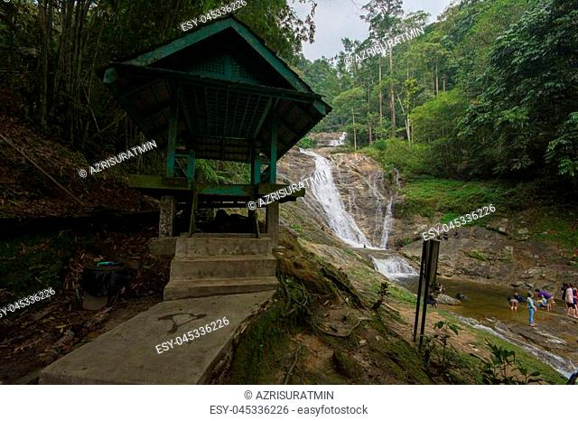 Lata Iskandar, Perak, Malaysia. March 25, 2018. A lady taking a rest at a Lata Iskandar waterfall, located along a trunk road from Tapah to Cameron Highland