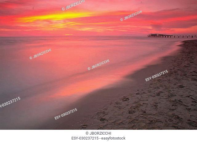 Beach in Tuscany with aModern steel pier in Lido Camaiore, Versilia, Tuscany, Italy, Europe