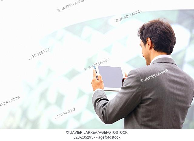 Business man with tablet in business center. San Sebastian Technology Park. Donostia. Gipuzkoa. Basque Country. Spain