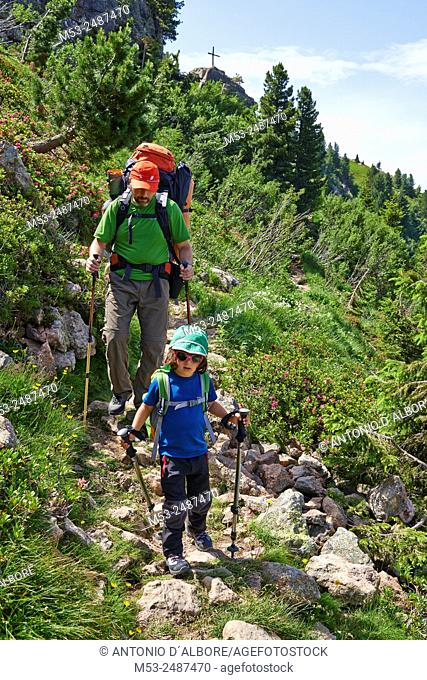 A father hiking with his four years daughter in the Lagorai Mountain Range. Province of Trento. Trentino-Alto Adige. Italy