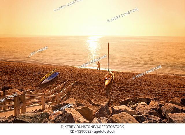 England Devon Beesands beach with beached kayaks