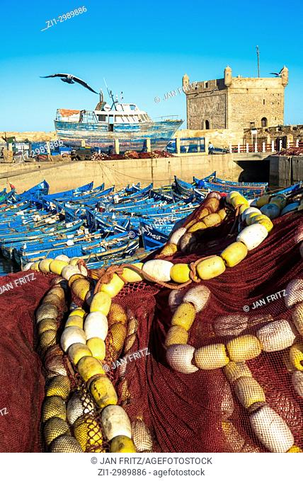 Fishing net and famous blue wooden boats in harbour of Essaouira, Maroc