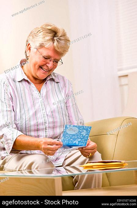 Senior woman reading note card