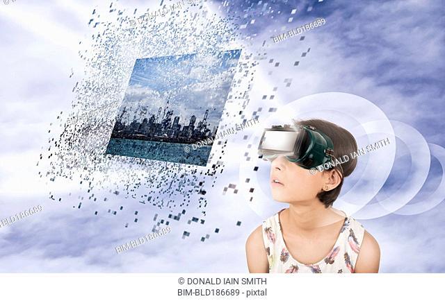 Mixed race girl watching virtual reality screen