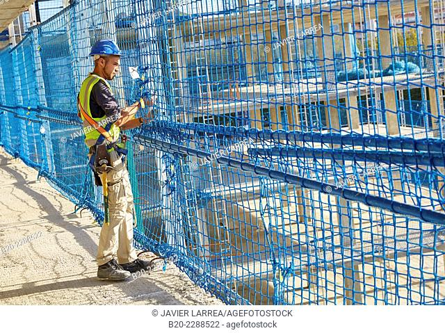 Worker placing Security System Work RESA. Protection in building work in construction. System that eliminates the possibility of people falling in the works