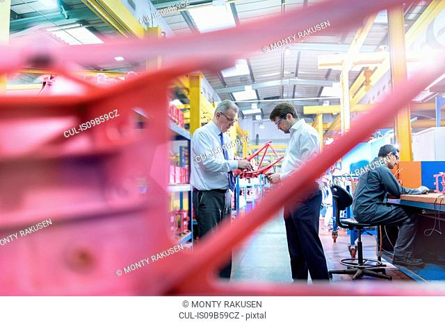 Workers inspecting wax components in precision casting factory