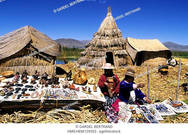 Peru, Puno Department, descendants of Uros Indians live on floating islands made with reed of Lake Titicaca and live thanks to tourism