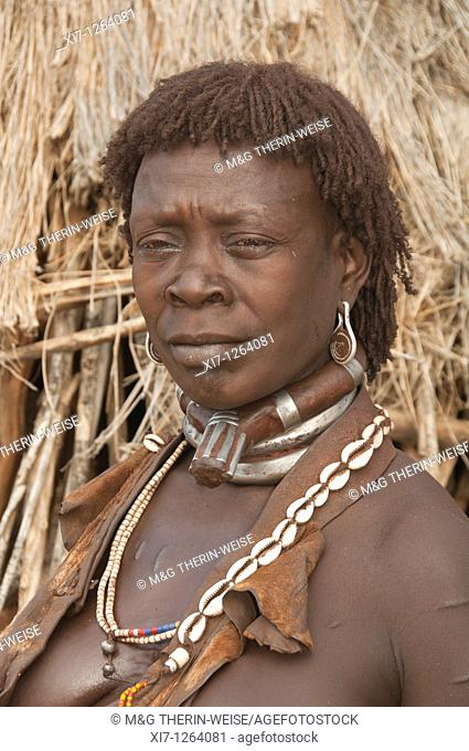 Married Hamar woman with necklaces made of Cowry shells, Omo river valley, Southern Ethiopia