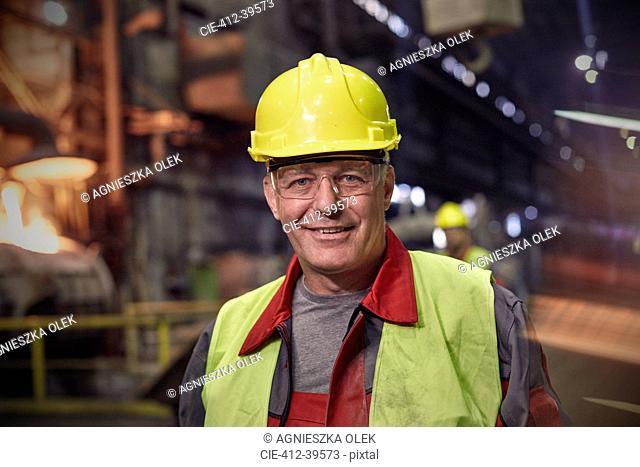 Portrait smiling, confident steelworker in steel mill