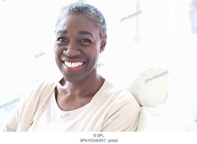 Portrait of mature woman smiling towards camera