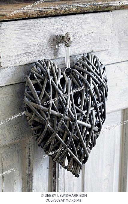 Heart shaped decoration, hanging on handle