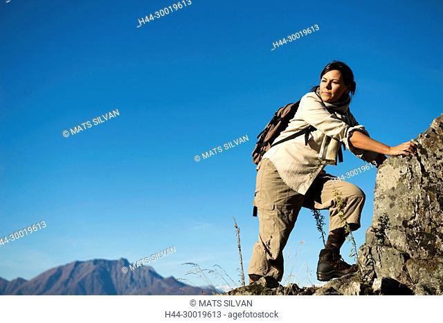 Woman Climbing a Mountain in Ticino, Switzerland