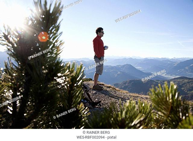 Austria, Tyrol, Unterberghorn, hiker at sunrise