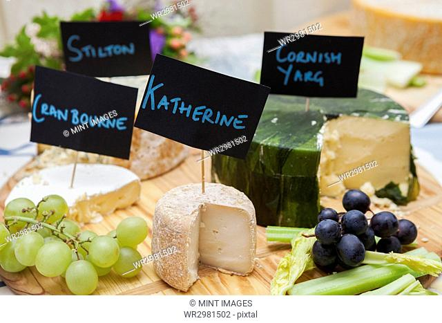 Close up of cheese board with a selection of English cheeses
