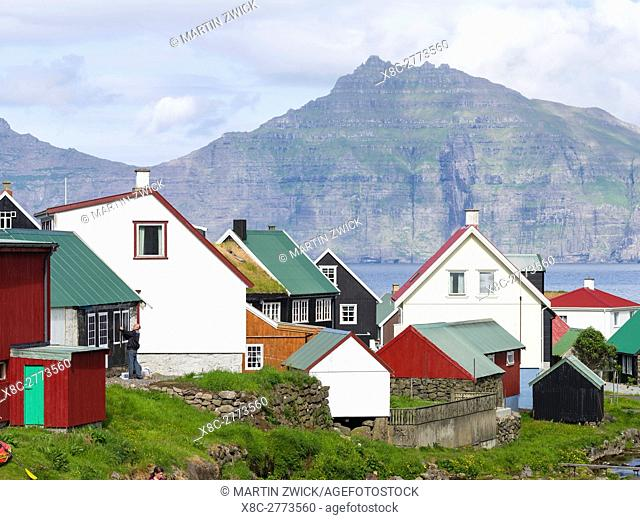 Village Gjogv, island Kalsoy in the background. The island Eysturoy one of the two large islands of the Faroe Islands in the North Atlantic