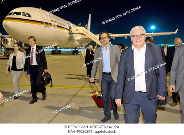 German Foreign Minister Frank-Walter Steinmeier (R) arrives at the airport of in Abu Dhabi, United Arab Emirates (UAE), 30 May 2014
