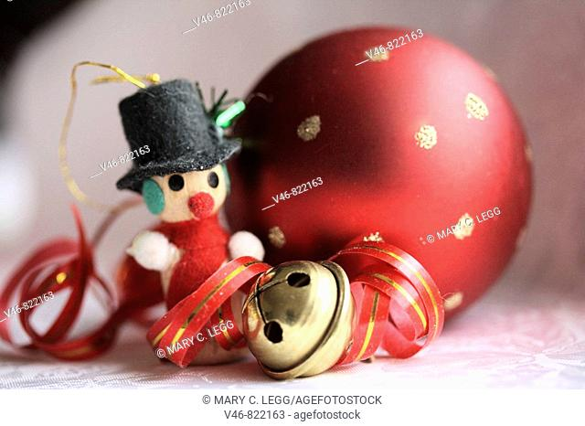 Miniature snowman, red Christmas ball and jingle bell with curled ed and gold ribbon