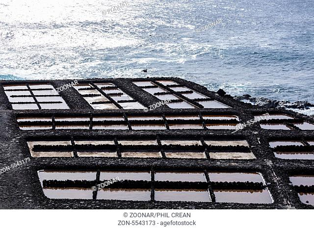 Saltwater ponds where sea salt production is carried out through desalination at Fuencaliente, La Palma, Canary Islands, Spain, Ponds in dormant winter period