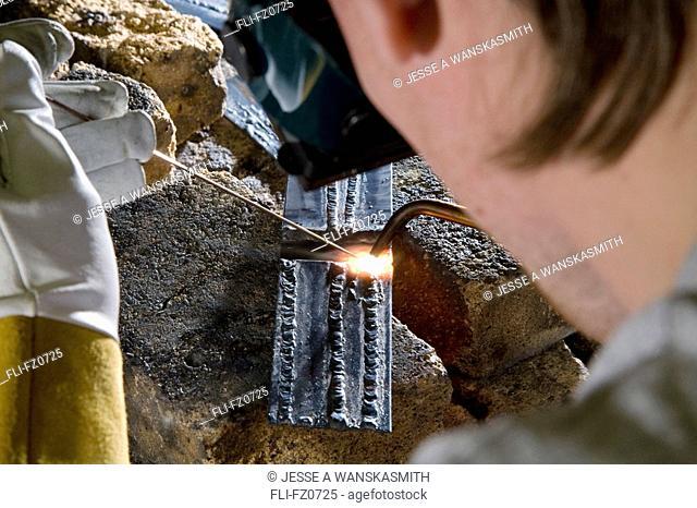 Airframe mechanic practices welding lines, Spokane, Washington