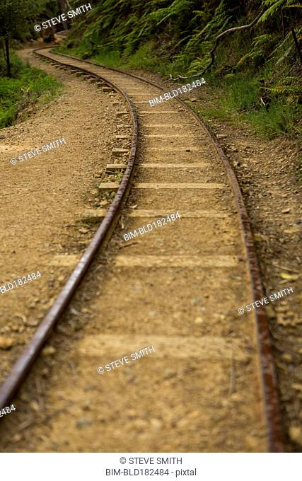 High angle view of train tracks in sand