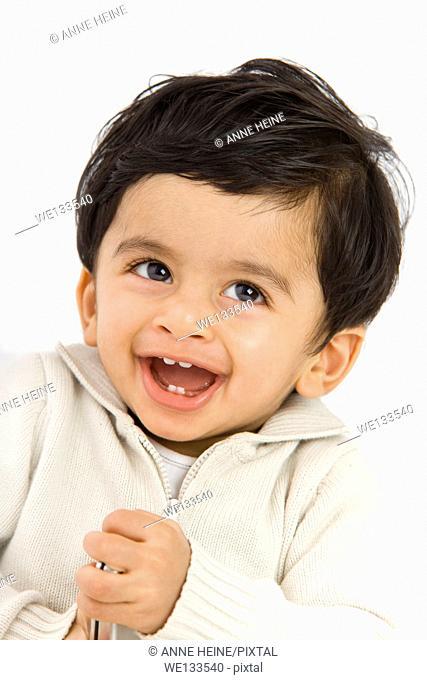 portrait of indian toddler boy laughing, fun, white