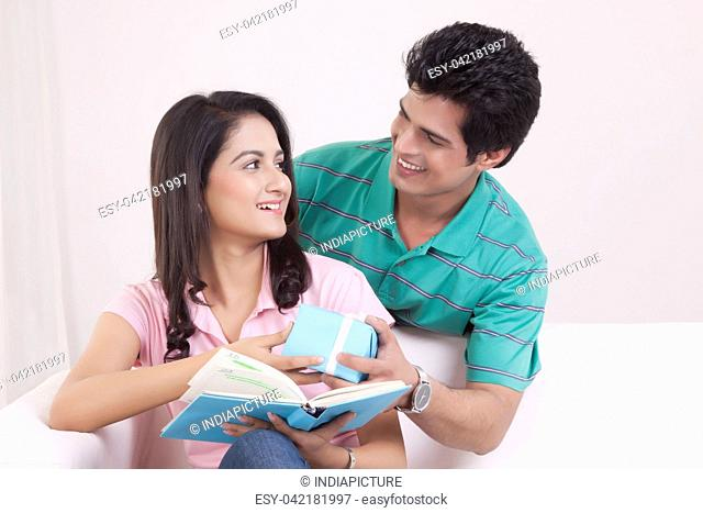 Man giving a gift to his woman friend