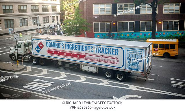 A truck carrying provisions for Domino's Pizza franchises is stopped at a traffic light in the Chelsea neighborhood of New York