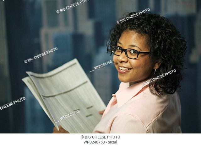 Young woman reading financial news