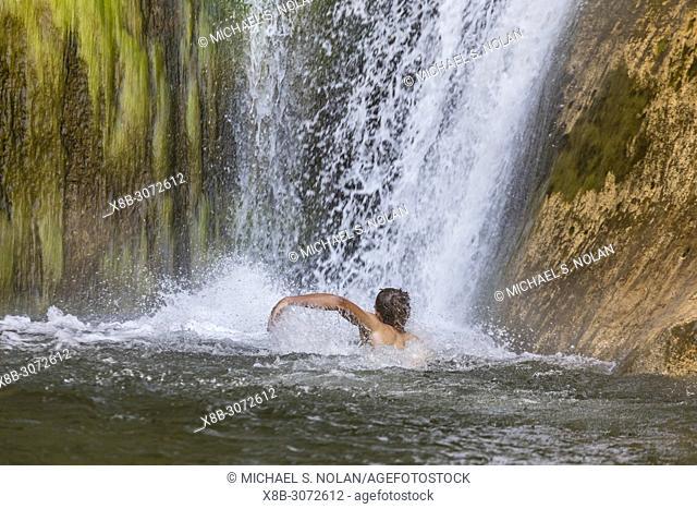 Man swimming in Lower Calf Creek Falls, Grand Staircase-Escalante National Monument, Utah, USA