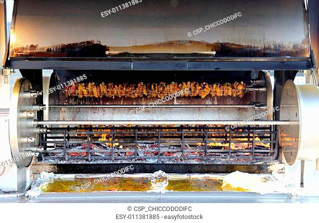 rotisserie full of cockerels and roast chickens