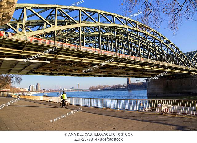 The Hohenzollern Bridge (German: Hohenzollernbrücke) is a bridge crossing the river Rhine in the German city of Cologne on Dec 5, 2016 Germany
