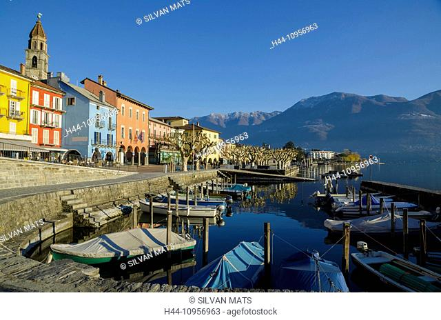 Alpine village ascona with blue sky and mountains and a small port with boats in ticino Switzerland, Europe