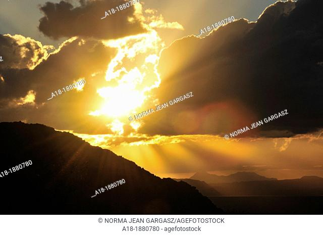 The setting sun illuminates Baboquivari Peak, in distance on left , the most sacred place to the Tohono O'odham people  Located 50 miles southwest of Tucson