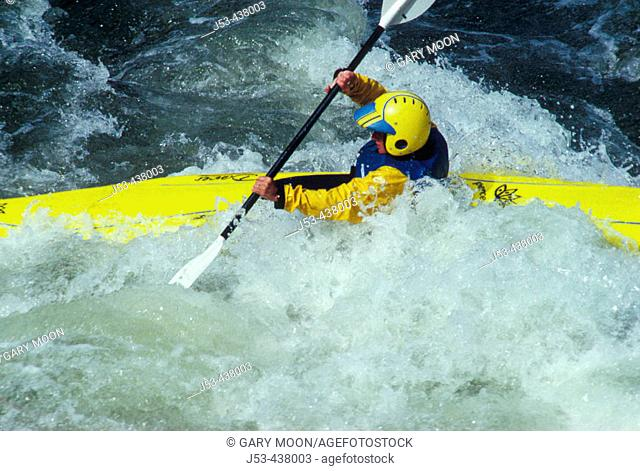 Female kayaker in whitewater, Merced River, Mariposa County California USA