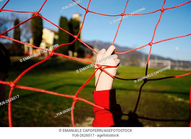Child in soccer goal