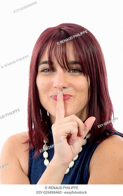 a beautiful young woman put a finger to her lips