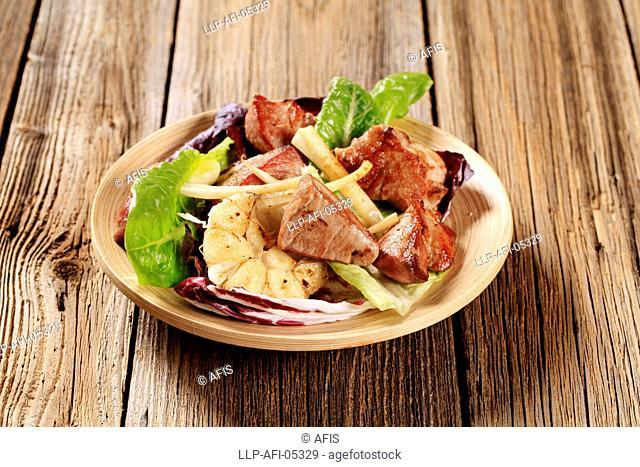 Pan fried pork and vegetable salad