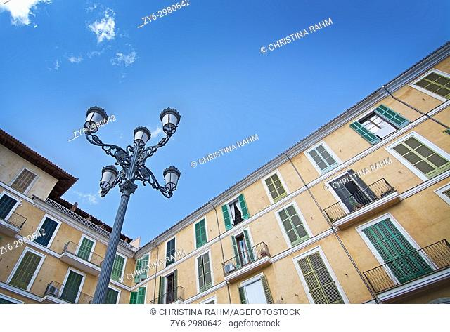 Buildings surrounding Plaza Mayor and blue sky in Palma de Mallorca, Spain