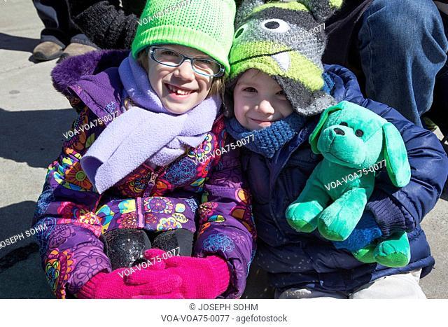 Two girls smile, St. Patrick's Day Parade, 2014, South Boston, Massachusetts, USA
